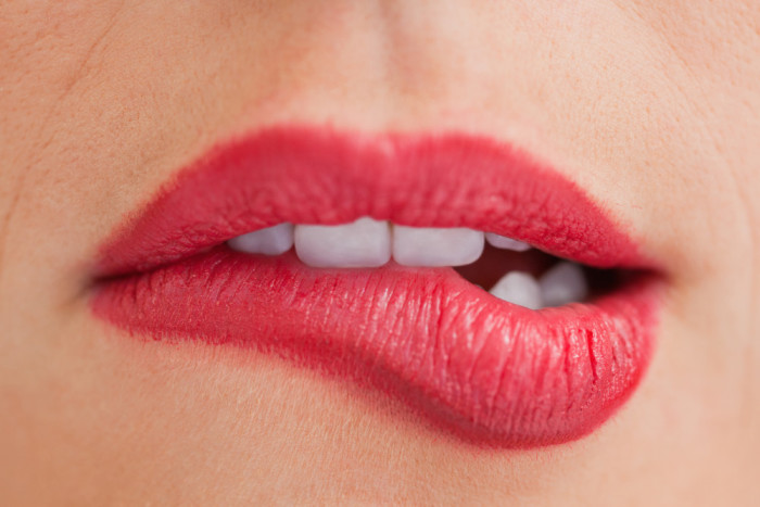 Disappearing lips and lip biting are a subconscious response to stress and anxiety, a reliable indication of negative emotion and that something is wrong.