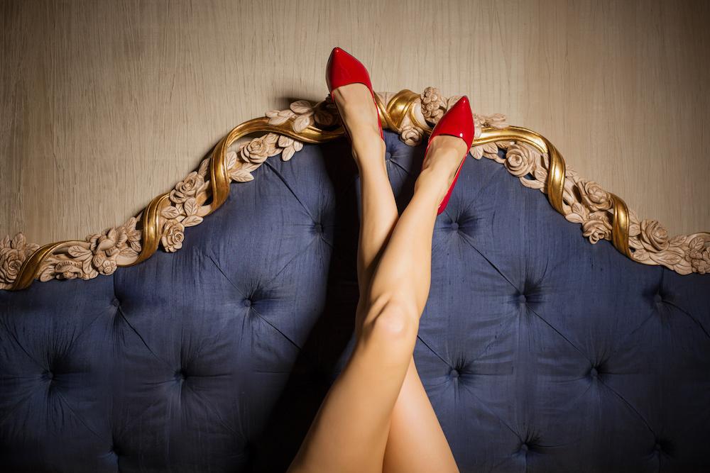 Sexy legs against luxury beds backboard
